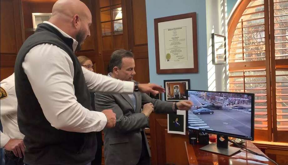 Bridgeport Officer Carlos Carmo Jr. was celebrated Monday after recently stopping an SUV that was rolling out of control toward a group of young people, according to the office of Mayor Joe Ganim. Photo: Office Of Mayor Joe Ganim