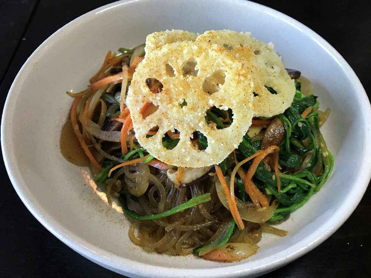 Chapjae from The Magpie includes glass noodles, mushrooms and other vegetables topped with crispy lotus root.