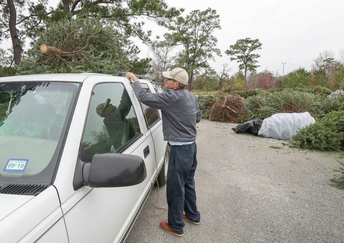 Byron Groce drops off his Christmas Tree at Memorial Park (Ball Fields 4 and 5) 7300 Memorial Drive Saturday, Dec. 29, 2018, in Houston. Over two dozen sites will accept Christmas trees for free recycling this year. http://www.houstontx.gov/solidwaste/tree2020.html