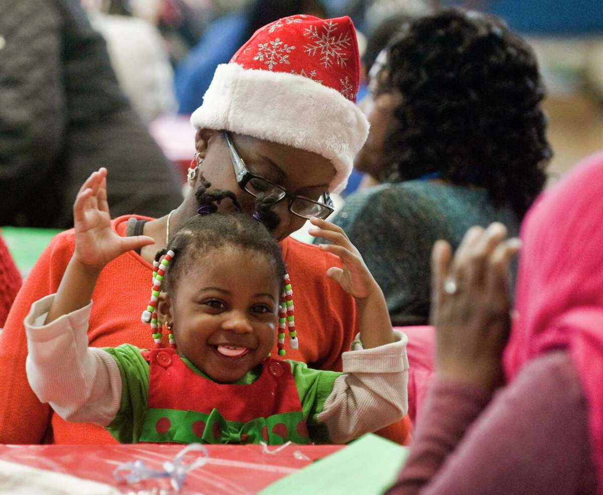 Jamie Bradley, of Stamford, and her daughter Mackaya, 2-1/2, have some fun at the Jackie Robinson Park of Fame's 41st Annual Christmas Extravaganza at the Yerwood Center. Sunday, Dec. 22, 2019