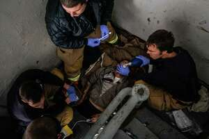 Manchester, N.H., firefighters try to revive a man who overdosed in a building's stairwell last year.