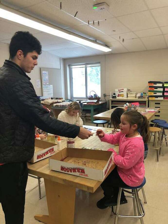Wamogo Regional High School seniors visited Goshen Center School Dec. 18 and handed out candy canes. Photo: Shawn Tobin / Contributed Photo /
