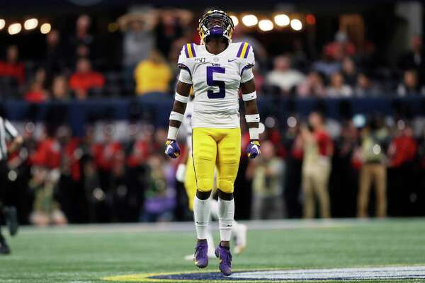 LSU cornerback Kary Vincent Jr. (5) reacts to an interception against Georgia during the first half of the Southeastern Conference championship NCAA college football game, Saturday, Dec. 7, 2019, in Atlanta. (AP Photo/John Bazemore)