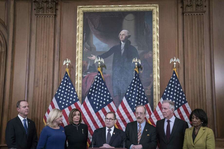One reader views the impeachment process as a sham, and another says Democrats have handed the president a gift. Photo: Sarah Silbiger / Getty Images / 2019 Getty Images
