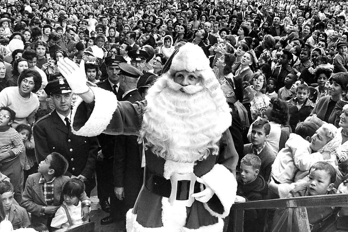 Pictured on Nov. 7, 1964: Santa Claus gets ready to take his spot inside the Emporium in downtown San Francisco.
