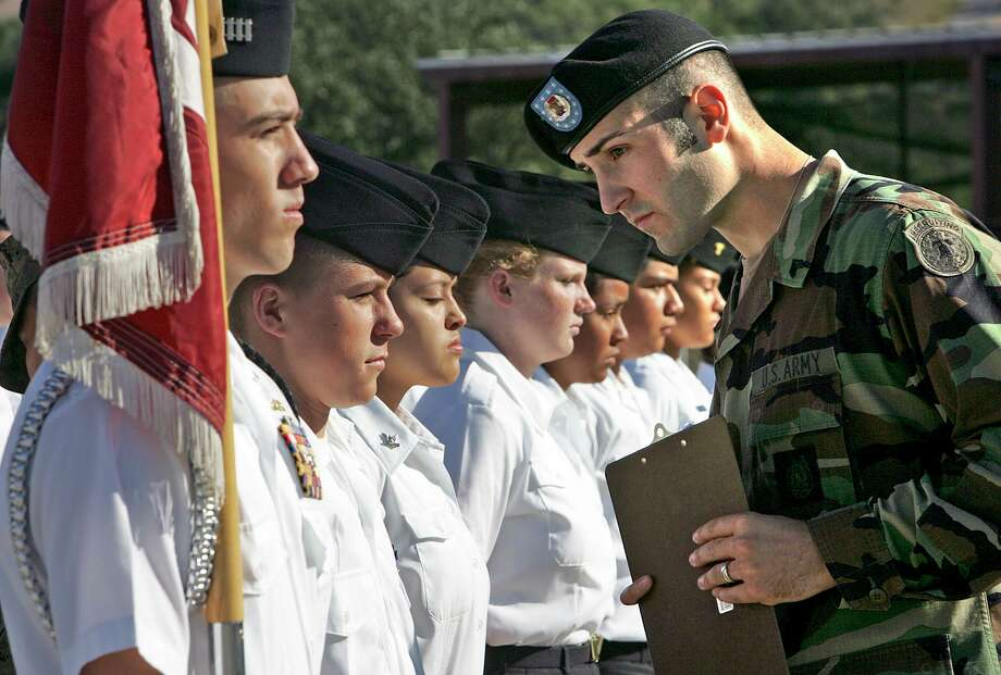 US Army Recruiter SGT Glenn Grabs, right, reviews the drill team from Bastrop High SChool NJROTC during the Smithson Valley Hill Country Challenge JROTC Drill Contest, Saturday, Oct. 8, 2005. Photo Bob Owen Photo: BOB OWEN, STAFF / SAN ANTONIO EXPRESS-NEWS / SAN ANTONIO EXPRESS-NEWS