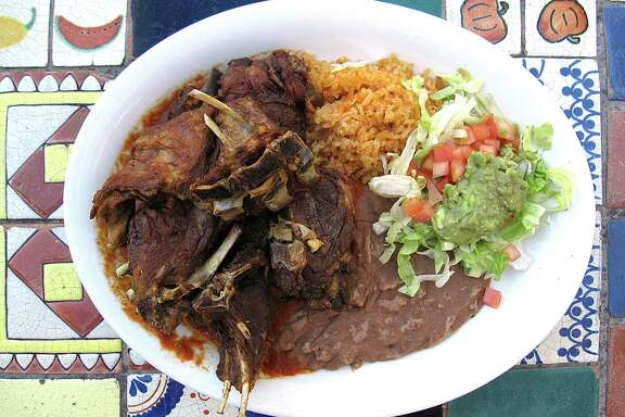 Roasted cabrito comes with ranchero sauce, rice, beans and guacamole salad at La Hacienda Scenic Loop.