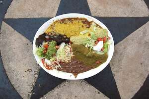 An enchilada sampler includes one enchilada ranchera, one enchilada creamy poblano, one enchilada verde, one enchilada poblana with mole and one Tex-Mex enchilada served with refried beans and guacamole at La Hacienda Scenic Loop.