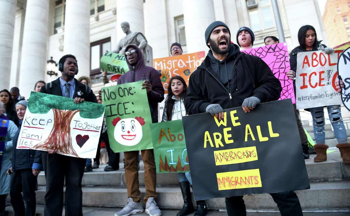 Supporters of Wilbur Cross High School student Mario Aguilar, 18, who was being held in detention by ICE in Boston, rally in front of Superior Court in New Haven on December 23, 2019.