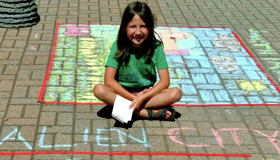 SPECTRUM/Eliza Shiff, 8, a New York City resident who vacations every summer in Kent, is a runnerup in the  sidewalk chalk art competition in front of Toys Galore & More during the Kent Sidewalk Festival, July 29-31, 2010 Photo: Cristina Bernardi / The News-Times Freelance