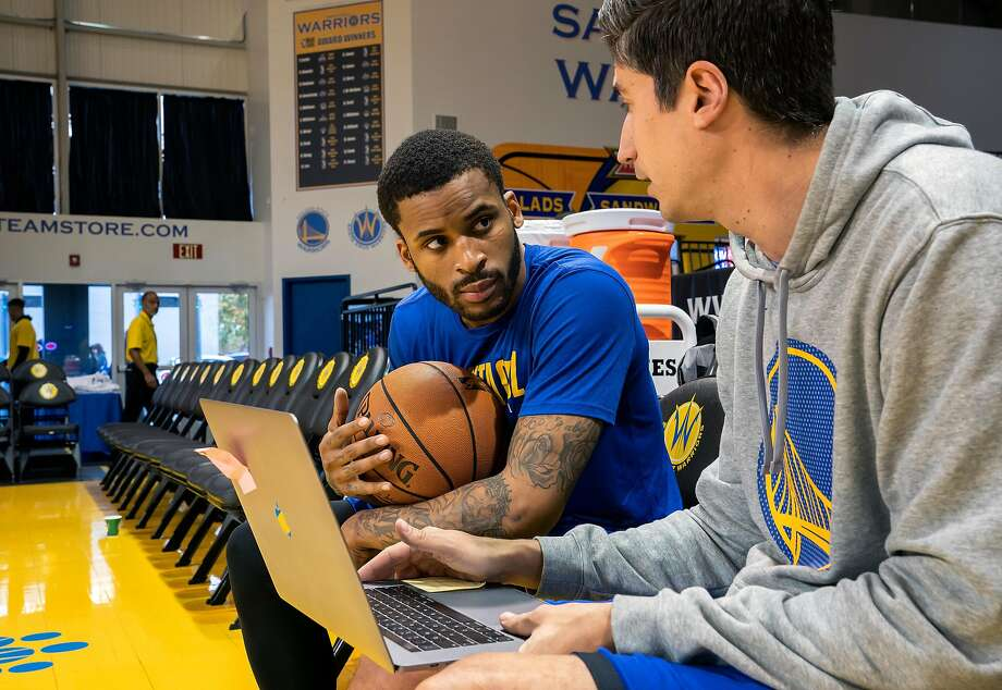 Santa Cruz Warriors guard Vander Blue, center left, talks with Warriors Assistant Coach James Andrisevic, before the NBA G League basketball game against the Windy City Bulls at the Kaiser Permanente Arena on Sunday, Dec. 8, 2019 in Santa Cruz, Calif. Photo: LiPo Ching / Special To The Chronicle