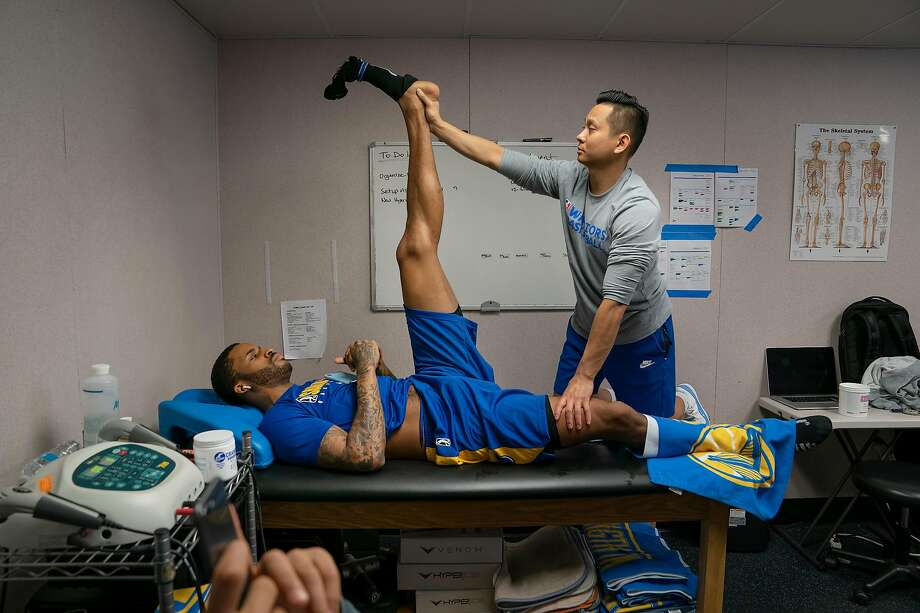 Santa Cruz Warriors Head Athletic Trainer Long Lam, right, helps Warriors guard Vander Blue with a stretch and soft tissue release before the NBA G League game against the Windy City Bulls at the Kaiser Permanente Arena on Sunday, Dec. 8, 2019 in Santa Cruz, Calif. Photo: Photos By LiPo Ching / Special To The Chronicle