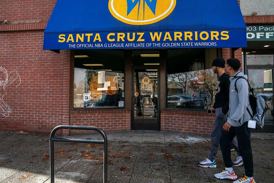 Santa Cruz Warriors guard Vander Blue, center right, walks with Warriors Basketball Operations and Team Player Development manager Mike Newton, right, past the Santa Cruz Warriors storefront after breakfast as they head back to the Kaiser Permanente Arena on Sunday, Dec. 8, 2019 in Santa Cruz, Calif. Photo: LiPo Ching / Special To The Chronicle