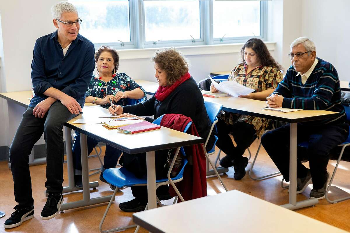 Steven Budd (left) with his students during a memoir writing course at City College of San Francisco?•s Mission Campus on Friday, Dec. 20, 2019, in San Francisco, Calif.