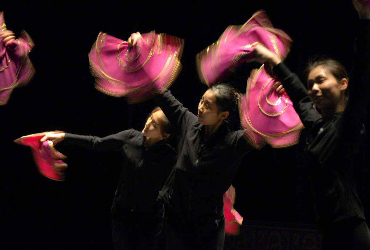 Dancers in the Chinese performance show Shen Yun run through a technical rehearsal at the Terrace Theater in Long Beach, Calif., on Friday, March 18, 2016.