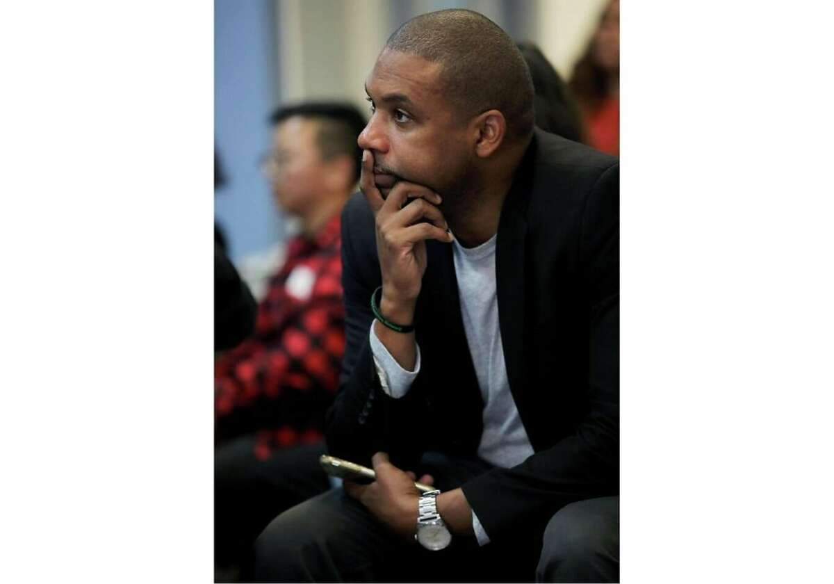 San Francisco District 10 supervisor Shamann Walton listens as panelists discuss the juvenile justice system during a town hall meeting at Excelsior Works in San Francisco, Calif., on Saturday, December 14, 2019.