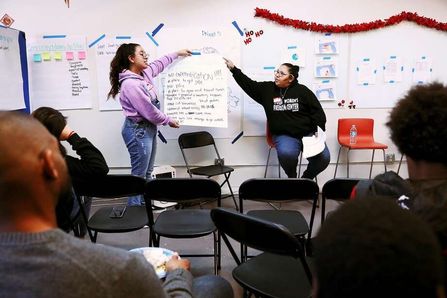 Itzel Estrada, left, and Krea Gomez, education director, Young Women's Freedom Center, present notes taken during a community mapping session at a town hall meeting at Excelsior Works in San Francisco, Calif., on Saturday, December 14, 2019. Photo: Yalonda M. James / The Chronicle