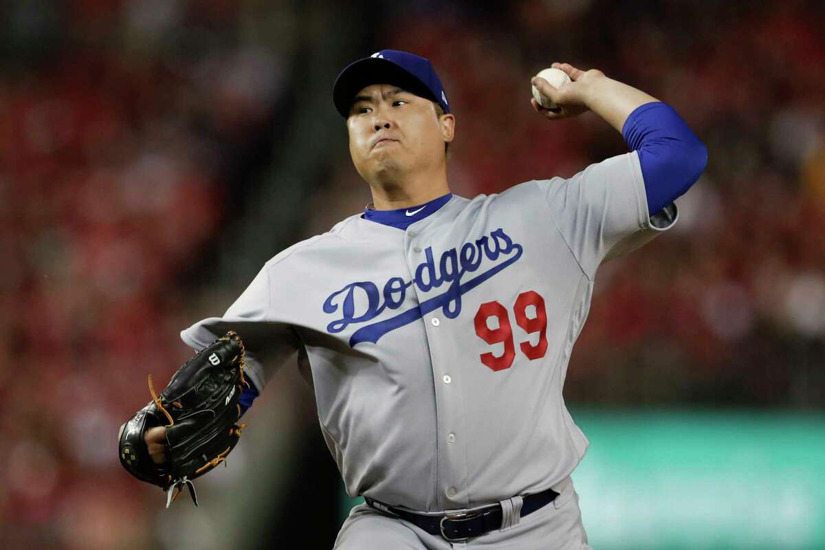FILE - In this Oct. 6, 2019, file photo, Los Angeles Dodgers starting pitcher Hyun-Jin Ryu throws to a Washington Nationals batter during the first inning in Game 3 of a baseball National League Division Series in Washington. Free agent pitcher Ryu and the Toronto Blue Jays have agreed to an $80 million, four-year contract, according to a person familiar with the negotiations. The person spoke on condition of anonymity because the deal was pending a physical sometime after Christmas and had not been announced. (AP Photo/Julio Cortez, File)