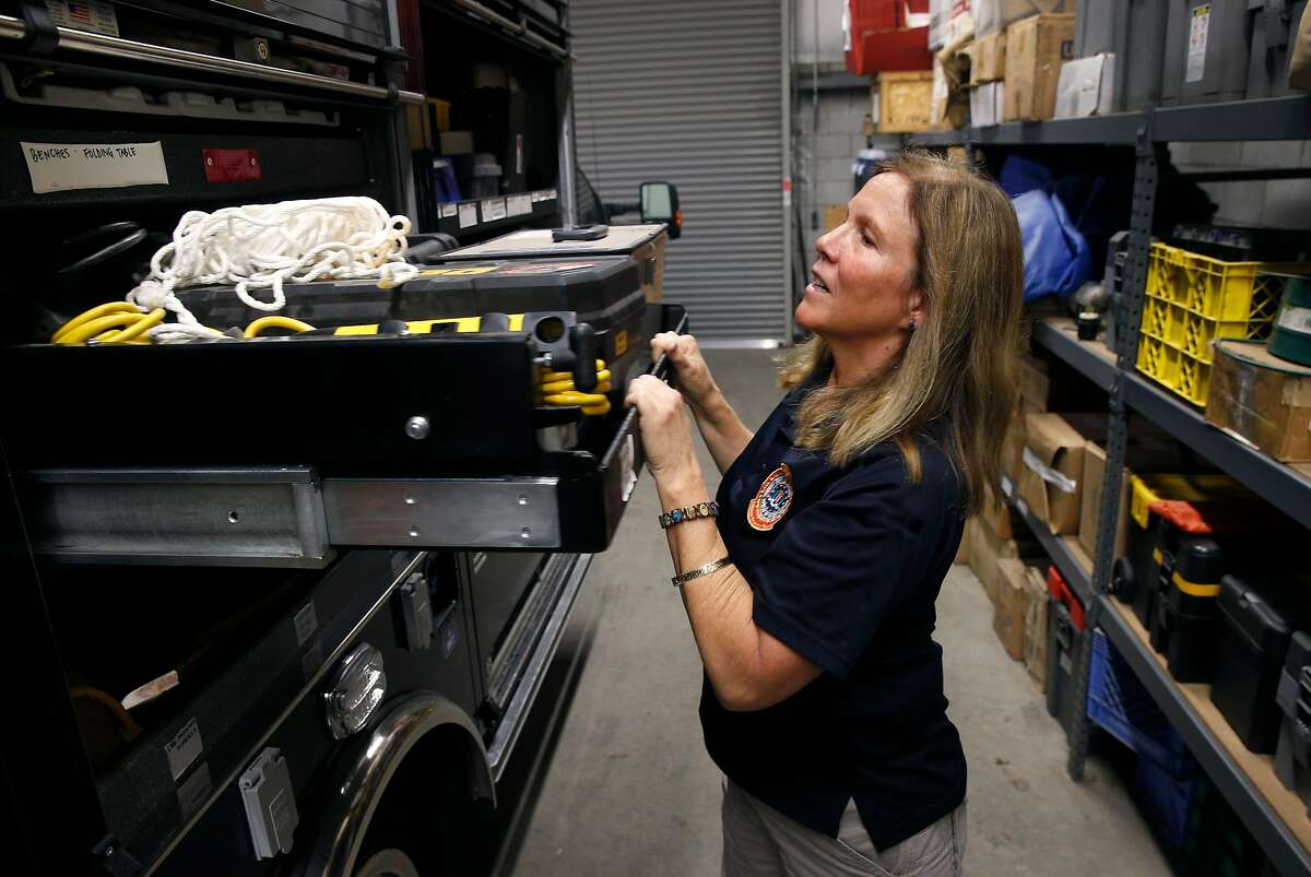 Gail Paresa, senior team leader of the Evidence Response Team for the FBI's San Francisco field office, opens a cabinet of the unit's mobile crime scene truck ready to respond from an undisclosed location in the East Bay on Tuesday, Dec. 17, 2019. The ERT has investigated several high profile cases including the Unabomber, the Polly Klaas kidnapping and murder and the recent Gilroy Garlic Festival mass shooting.