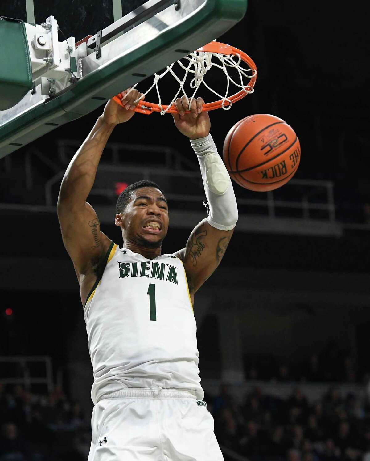 Siena's Elijah Burns dunks the ball during a basketball game against Canisius on Monday, Dec. 23, 2019 in Albany, N.Y. Burns made the winning three-pointer to win the game. (Lori Van Buren/Times Union)
