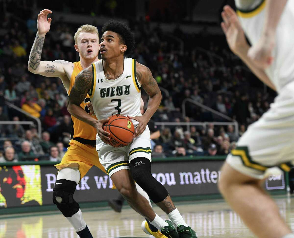Siena's Manny Camper drives to the hoop against Canisius during a basketball game on Monday, Dec. 23, 2019 in Albany, N.Y. (Lori Van Buren/Times Union)