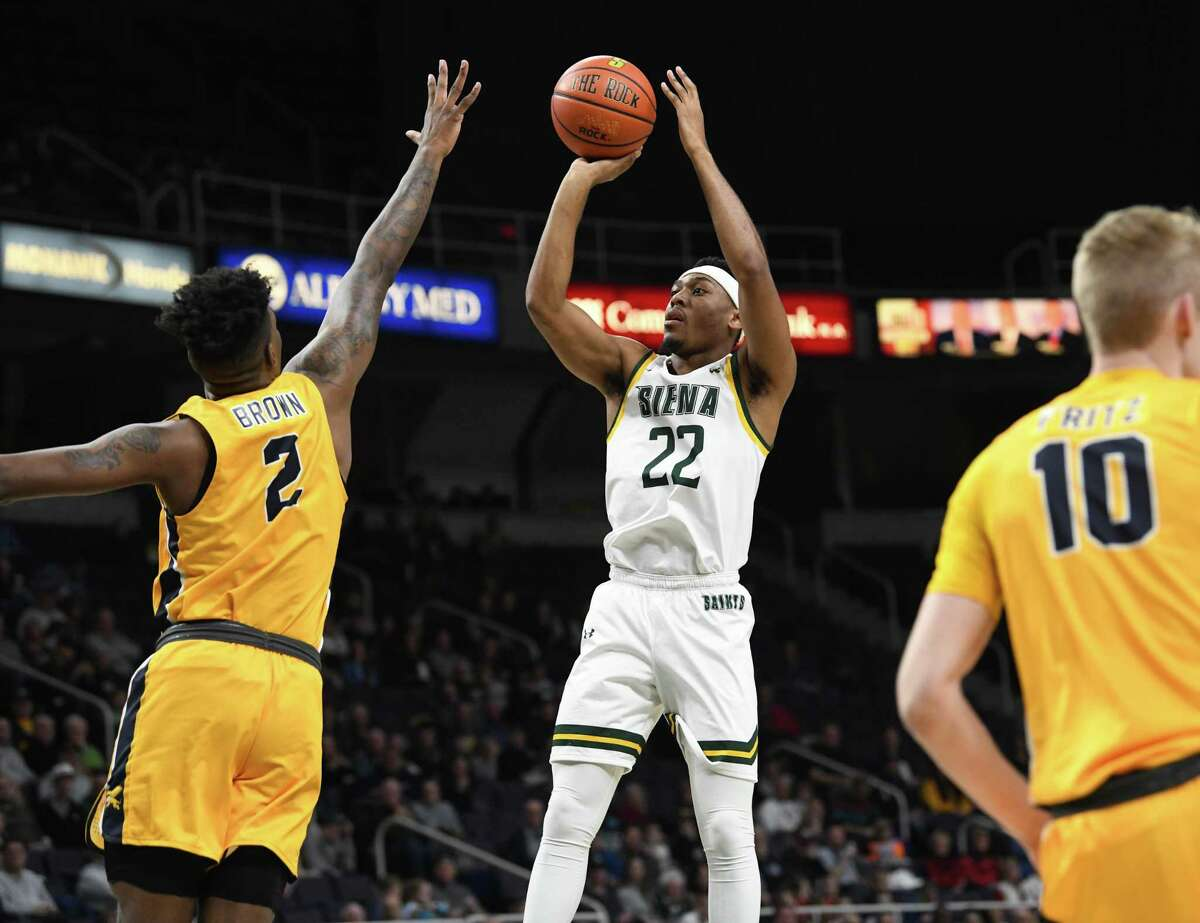 Siena's Jalen Pickett takes a jump shot against Corey Brown of Canisius during a basketball game on Monday, Dec. 23, 2019 in Albany, N.Y. (Lori Van Buren/Times Union)