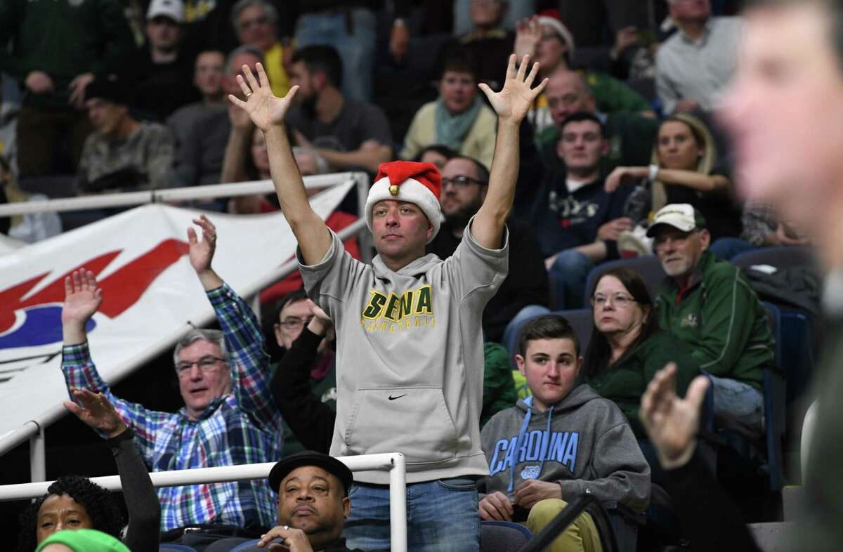 A Siena fan is in the Christmas spirit as he watches a basketball game against Canisius on Monday, Dec. 23, 2019 in Albany, N.Y. (Lori Van Buren/Times Union)