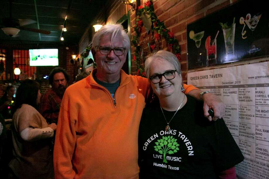 Green Oaks Tavern owners Steve and Debbie Bixby pose in their bar. They met down the street listening to live musicat the Catus Moon which closed in 2003. Photo: Savannah Mehrtens/Staff Photo / Savannah Mehrtens/Staff Photo