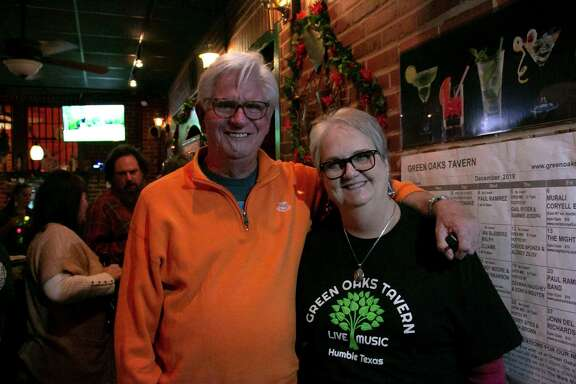 Green Oaks Tavern owners Steve and Debbie Bixby pose in their bar. They met down the street listening to live music at the Catus Moon which closed in 2003.