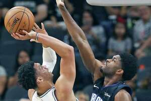 Monday's game at Memphis was a homecoming of sorts for Spurs rookie and Austin Spurs member Quinndary Weatherspoon, left, who grew up in Canton, Miss.