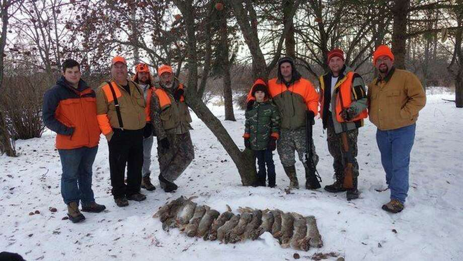 """Fourteencottontails were taken on theLounsbury family Christmas rabbit drive in 2014. """"Da Turty-Pound"""" rabbit was also sighted that year byfour of the hunters, but escaped unscathed due to its shocking size and sudden appearance. (Photo provided by Tom Lounsbury/Hearst Michigan)"""