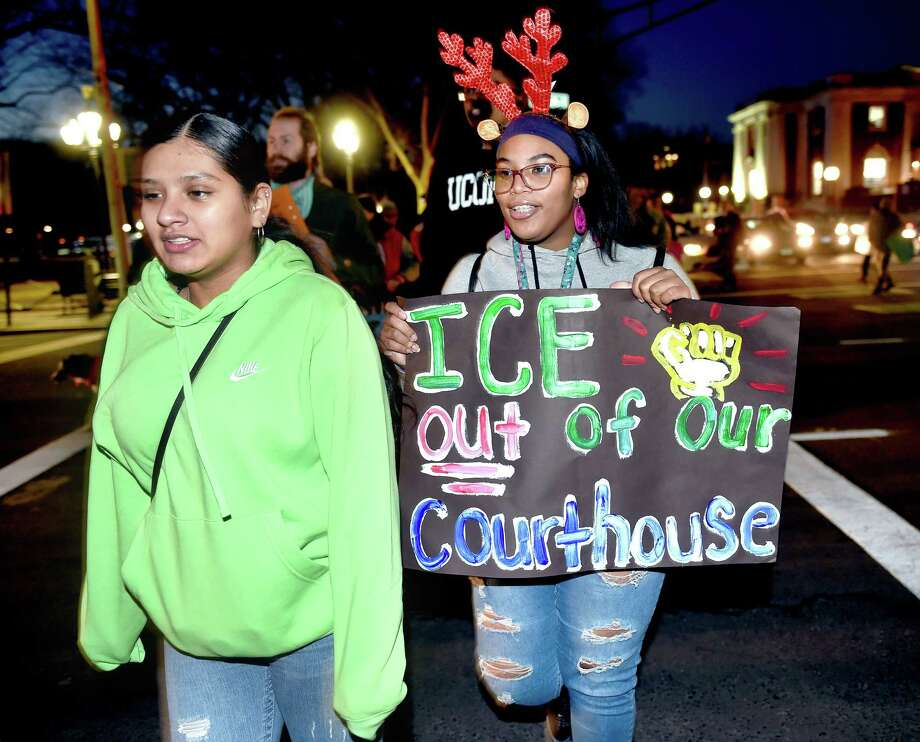 Wilbur Cross High School students Angeli Arevalo (left), 17, and Dajia Carr, 17, participate in a rally for classmate Mario Aguilar, 18, who was being held in detention by ICE in Boston, as it moves from Superior Court to City Hall in New Haven on December 23, 2019. Photo: Arnold Gold / Hearst Connecticut Media / New Haven Register