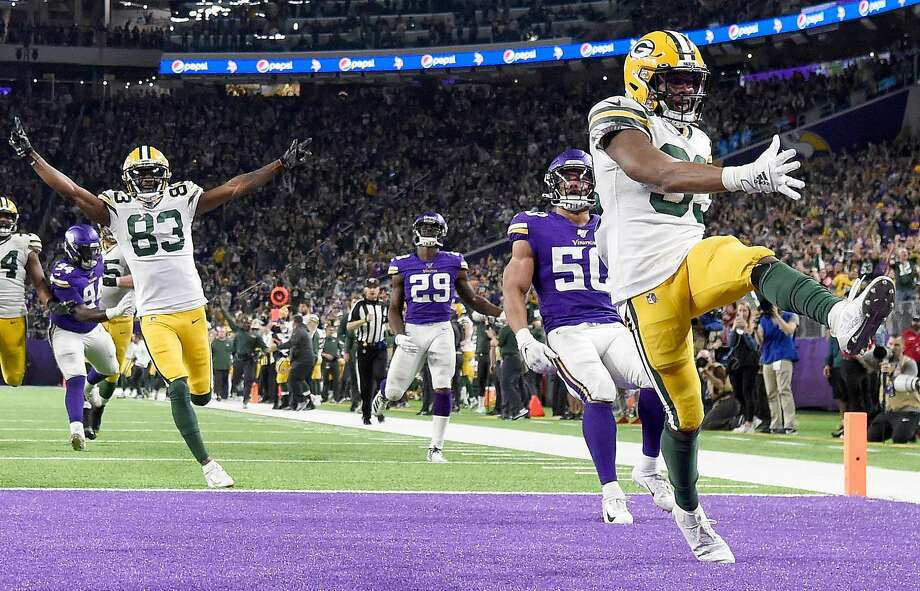 Running back Aaron Jones (right) of the Green Bay Packers celebrates after scoring a touchdown in the third quarter of a win over the Vikings in Minneapolis. Photo: Hannah Foslien / Getty Images