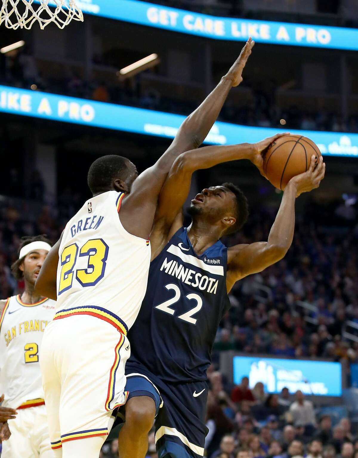 SAN FRANCISCO, CALIFORNIA - DECEMBER 23: Andrew Wiggins #22 of the Minnesota Timberwolves tries to shoot over Draymond Green #23 of the Golden State Warriors at Chase Center on December 23, 2019 in San Francisco, California. NOTE TO USER: User expressly acknowledges and agrees that, by downloading and/or using this photograph, user is consenting to the terms and conditions of the Getty Images License Agreement. (Photo by Ezra Shaw/Getty Images)