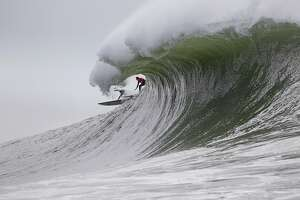 John Mel, right, and another surfer, vie for the same wave at Mavericks on Friday December 13, 2019 in Half Moon Bay, California.