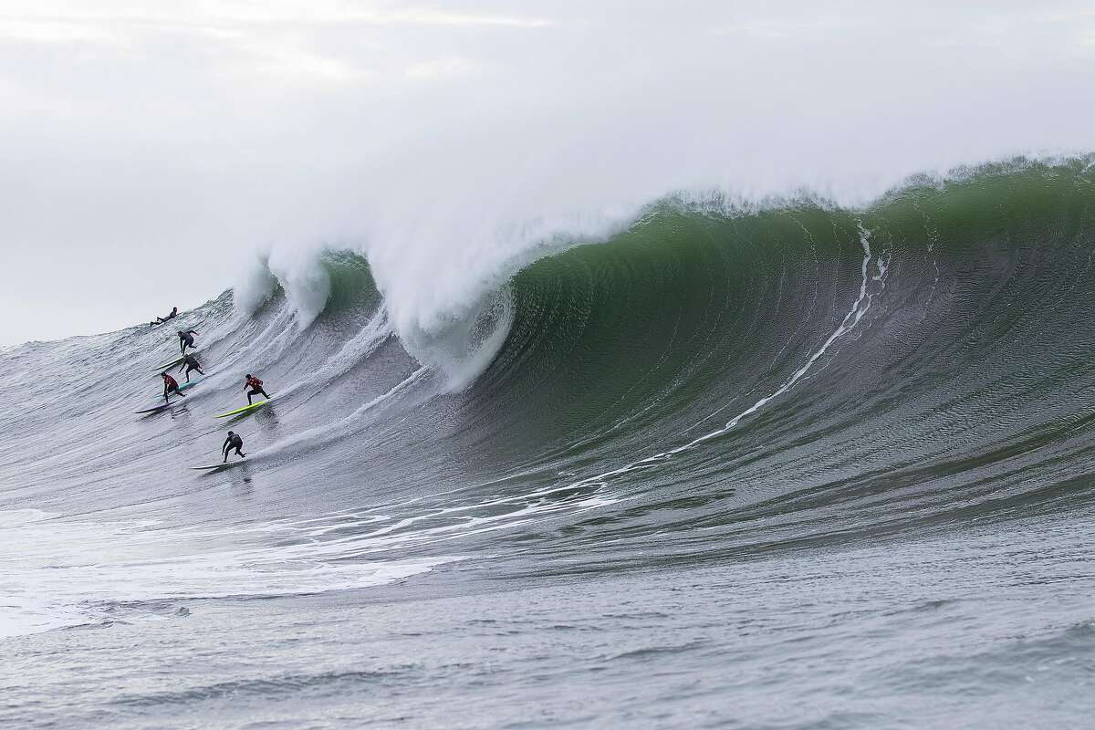 Surfers fight for position on a big wave at Mavericks on Friday December 13, 2019 in Half Moon Bay, California.