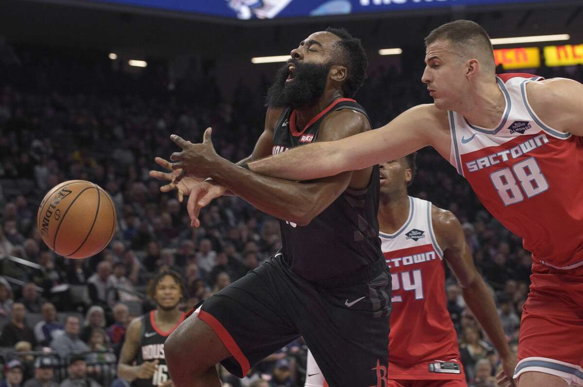 Houston Rockets guard James Harden (13) is fouled by Sacramento Kings forward Nemanja Bjelica (88) during the first half of an NBA basketball game in Sacramento, Calif., Monday, Dec. 23, 2019. (AP Photo/Randall Benton)