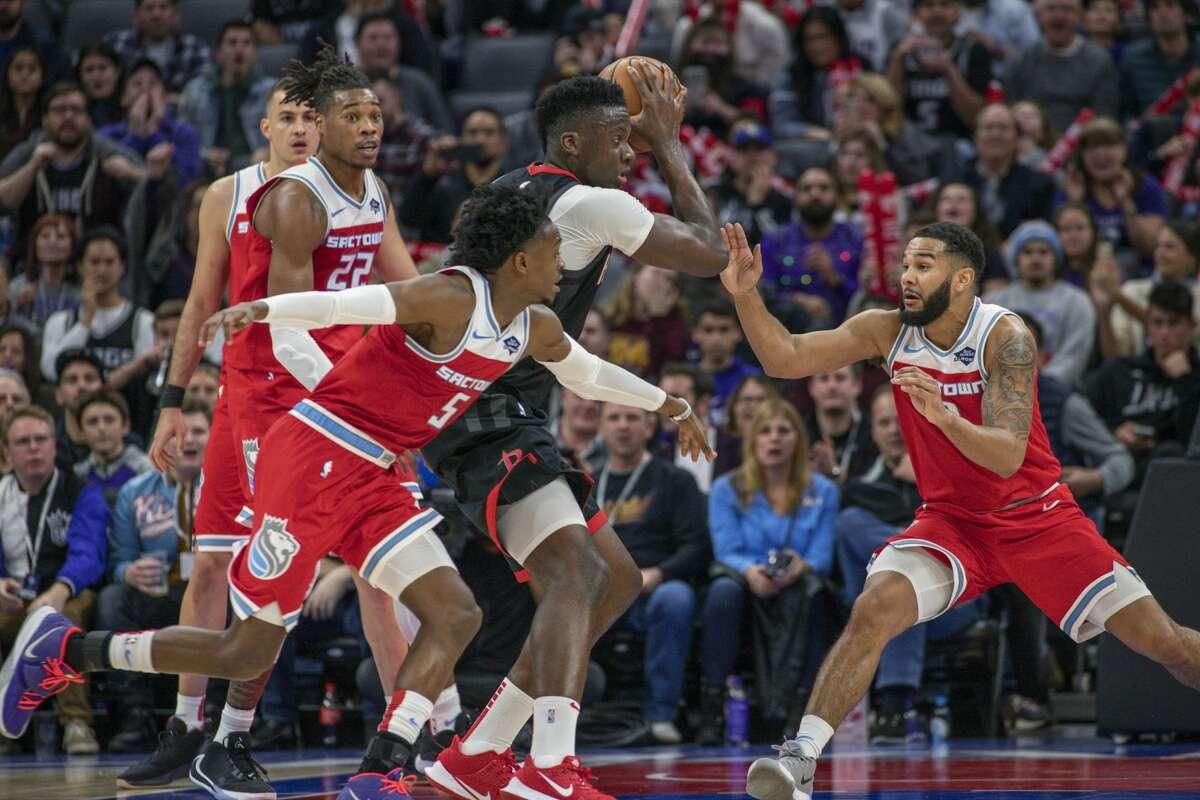 Houston Rockets center Clint Capela (15) grabs a rebound as Sacramento Kings forward Richaun Holmes (22), guard De'Aaron Fox (5) and guard Cory Joseph (9) defend during the second half of an NBA basketball game in Sacramento, Calif., Monday, Dec. 23, 2019. The Rockets won 113-104. (AP Photo/Randall Benton)