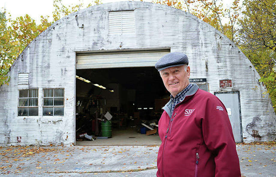 Professor Seburn Pense, who teaches agricultural education and agricultural communications at Southern Illinois University Carbondale, stands in front of the university's World War II-era Quonset Hut. Photo: Gabe Neely-Streit | Southern Illinoisan (AP)