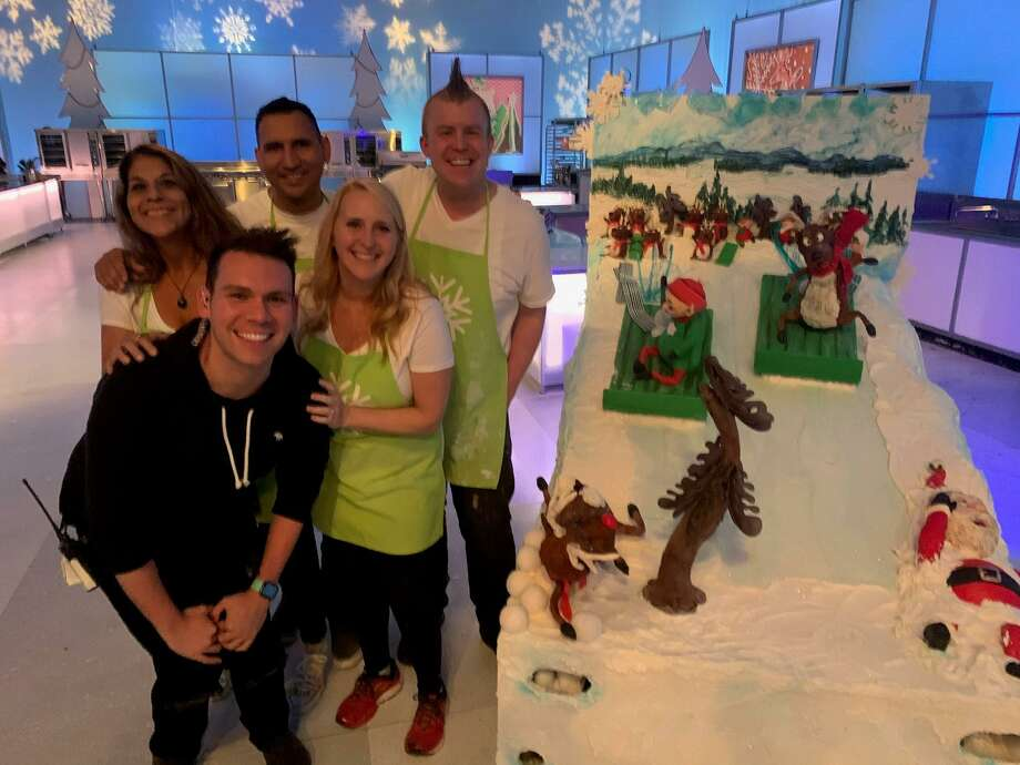 """Bethany Davis and her team members, winners of Food Network """"Holiday Wars."""" Their winning cake showed reindeer and elves competing in sledding on a mountain of snow. Photo: Paul Wedding"""