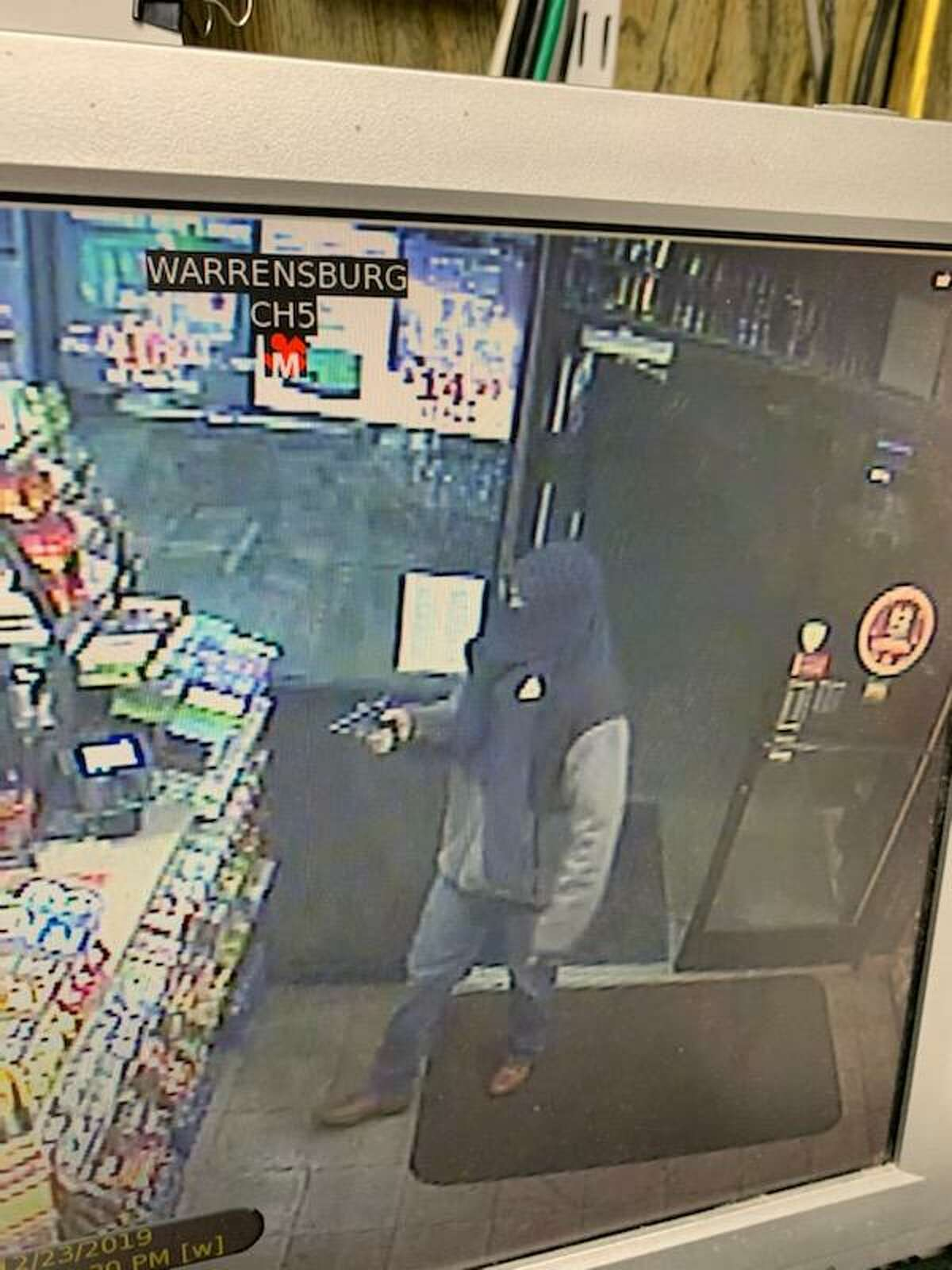 A surveillance photo of the man who robbed a Lake George gas station on Monday evening.