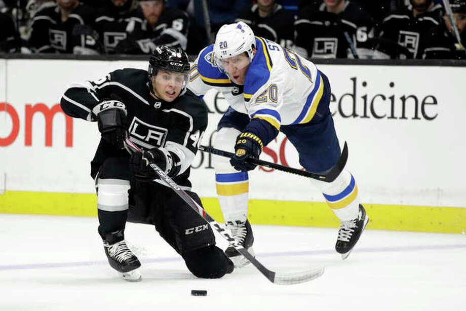 The Kings' Blake Lizotte (left) is defended by the Blues' Alexander Steen during the second period Monday night in Los Angeles. Photo: Associated Press