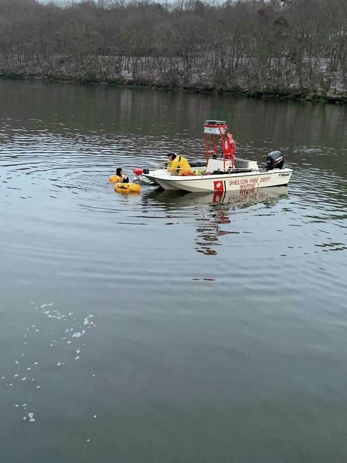 Shelton Fire companies 1,4, and 5 responded to the Housatonic River for the reported water rescue on Saturday, Dec. 21, about 4 p.m. Photo: Shelton Fire Department / Contributed Photo / Connecticut Post