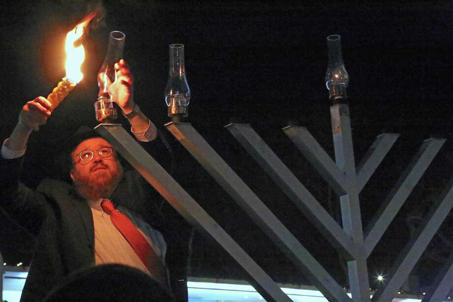 Rabbie Levi Stone lights the menorah at the Beth Israel Synagogue Chabad of Westport-Norwalk's menorah lighting on Dec. 23, 2019, in Westport. Photo: Jarret Liotta / For Hearst Connecticut Media / Jarret Liotta / ©Jarret Liotta