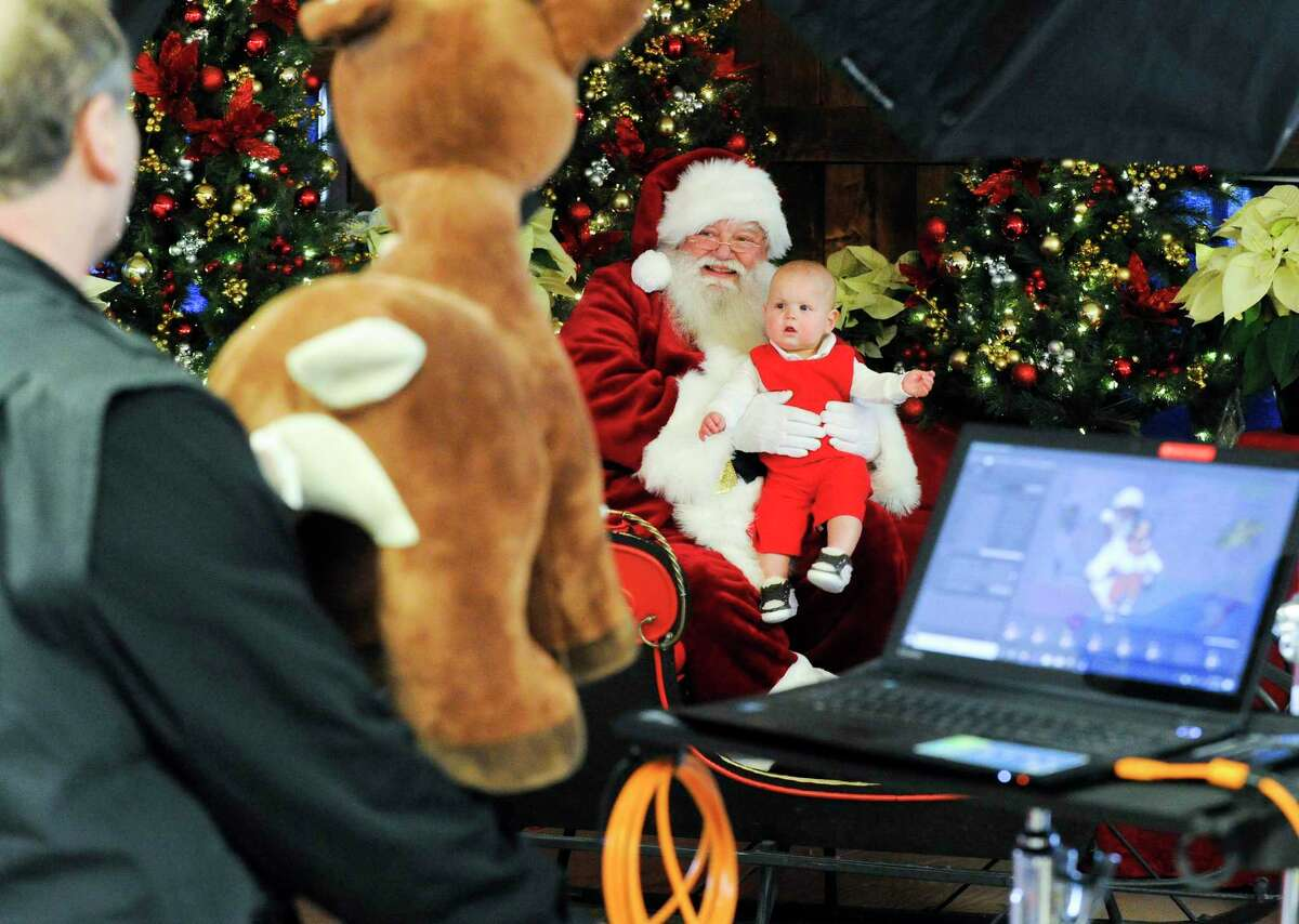 Santa (Walter Kelly of Greenwich) and nine-month-old Brooks O'Callaghan pose for Alex Rosenfeld Photography as he takes a holiday photo at Santa's Workshop at the Greenwich Reindeer Festival & Santa's Village at Sam Bridge Nursery & Greenhouses in Greenwich, Conn. on Dec. 19, 2019. With the upcoming holiday, the reindeer will be leaving to head back to the North Pole on Saturday and Santa and his band of Merry helpers will be closing on Christmas Eve. So if you want to get those last minute holiday photos and pick up some joyful cheer, come visit the Festival & Santa's Village. For times and other information visit: https://www.greenwichreindeerfestival.com