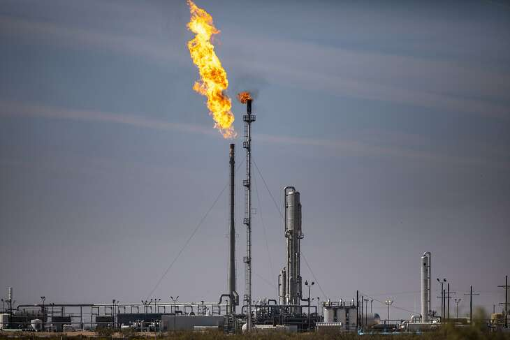 A gas flare at the Targa Driver Gas Plant in the Permian Basin in Texas, Nov. 5, 2019. Immense amounts of methane are escaping from oil and gas sites nationwide, worsening global warming, even as the Trump administration weakens restrictions on offenders. (Jonah M. Kessel/The New York Times)