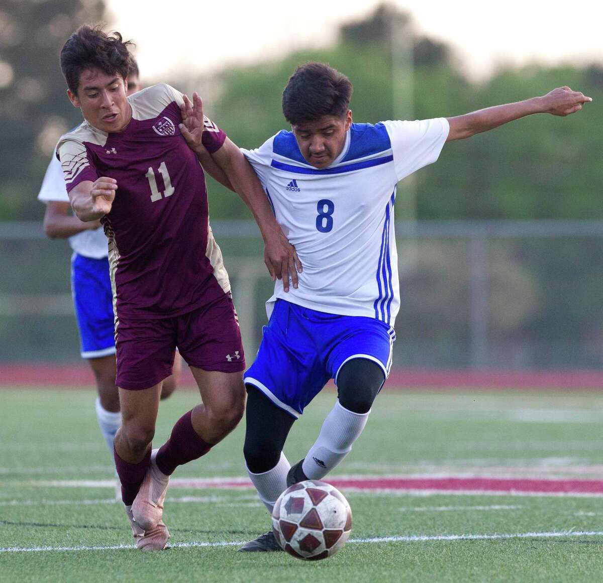 Magnolia West midfielder Carlos Larios (11) battles Ricardo Ramirez #8 of New Caney for the ball during the first period of a Region III-5A bi-district soccer match at Magnolia West High School, Friday, March 29, 2019, in Magnolia.