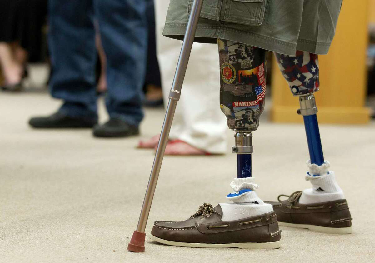The prostestic legs of former Texas Representative and Montgomery County Judge Jimmie Edwards III are seen during Commissioners Court at the Alan B. Sadler Administration Building on Tuesday, March 28, 2017, in Conroe. Edwards lost both legs after being hit by a mortar shell while serving in Vietnam in 1969.