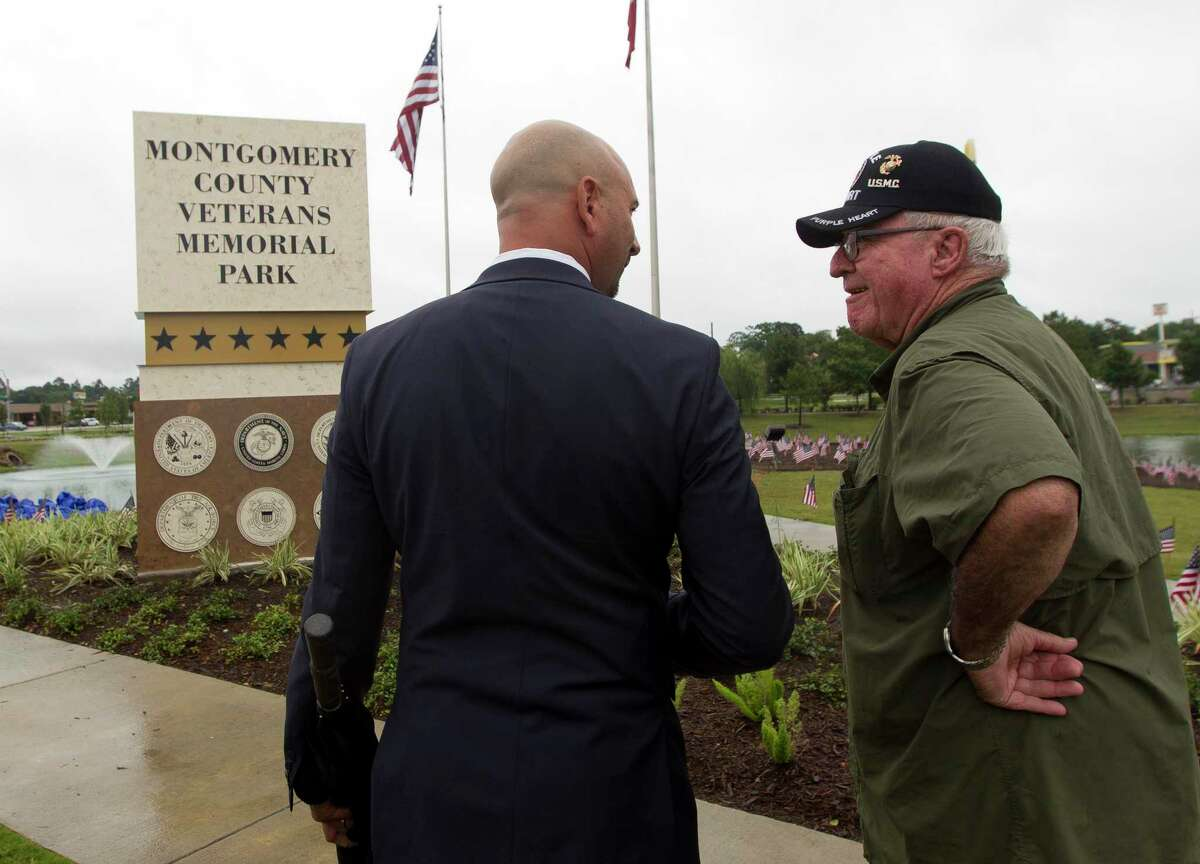 Retired United States Marine Corps Cpl. Jimmie Edwards III, right, speaks with Conroe Assistant City Administrator Steve Williams during a D-Day observance ceremony and dedication of the Montgomery County Veterans Memorial Monument, Wednesday, June 5, 2019, in Conroe.