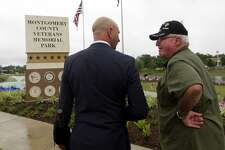 Retired United States Marine Corps Cpl. Jimmie Edwards III, right, pictured in this file photo with Conroe Assistant City Administrator Steve Williams during a D-Day observance ceremony, said he is determined to get the state to install directional signs for the Montgomery County Veteran's Memorial and Flag Park along Interstate 45.